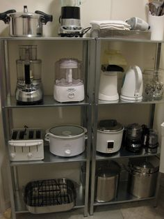 This is a great picture that shows off some great organization in a kitchen shelving unit. #kitchen #cool #goodidea
