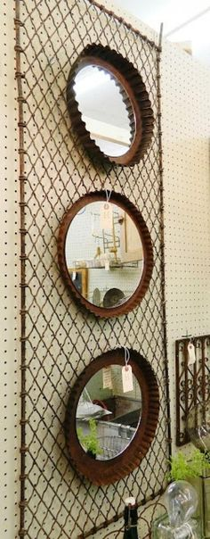 tart tins repurposed into decorative mirrors - would be great on the wall of an eat-in kitchen or rustic chic dining room!