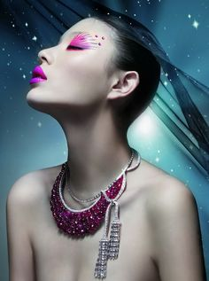 Artistic pink 'eye art' with a trio of pink crystals and vibrant pink lips.
