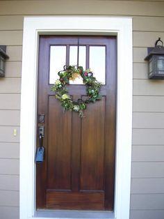 easy diy upgrade with emtek modern door magnolia wreath and door sets