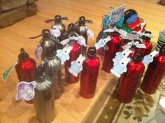 what a fun idea for christmas gifts for my kiddos! :) water bottles from the dollar tree using a cricut to personalize!