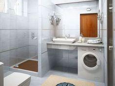 Une machine à laver sous le plan de travail de la salle de bains