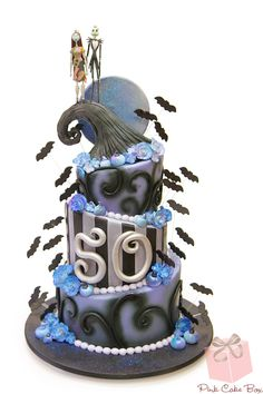 Halloween is coming!  This cake pays homage to Nightmare before christmas and was created for a 50th Birthday!