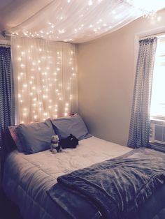 DIY light canopy: Materials: 2, 63 inch 2 panel sheer curtains 2 garden hooks 1 curtain rod (round cylinder) 2 curtain rods that anchor into wall Fairy string lights  #DIY #canopy #stringlights #fairybed #cozy #bed #bedroom