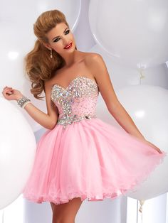 2720 - This stunning exquisite dress is perfect for your prom, sweet 16, semi, or homecoming! It features a sweetheart neckline, studded bodice with beautifully packed sparkling crystals, and a poofy skirt with many layers of tulle! This dress comes in a variety of colors and is only here for a short time, come into Glitterati in Danvers, MA to find out more information on the dress of your dreams!