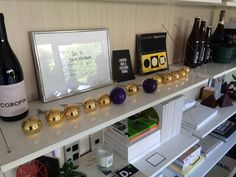 Best Design Awards Purple and Gold Pins on display