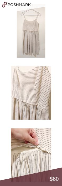 """J. Crew Linen Dress - Cream & Blue Stripes Only worn once, beautiful and airy cotton linen short dress. Cream colored with thin blue stripes, it appears to be two pieces but it is actually one (see photo). Side zipper. Dress has no stretch. No flaws. Bust is approx. 17"""" across lying flat. Shoulder to hem is approx. 35"""". J. Crew belt and blue sweater shrug from photo also available in separate listings. J. Crew Dresses Midi"""