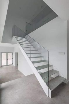 Image 19 of 28 from gallery of Dwelling / Viraje arquitectura. Photograph by German Cabo Staircase Handrail, Stair Railing, Bannister, Floating Staircase, Modern Staircase, Pool Coping Tiles, Interior Design And Construction, Glass Stairs, Steel Stairs
