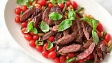 Everyday Food editor Sarah Carey cooks up a succulent steak and bean salad and demonstrates how to prep, cook, and cut skirt steak so it's juicy and tender.