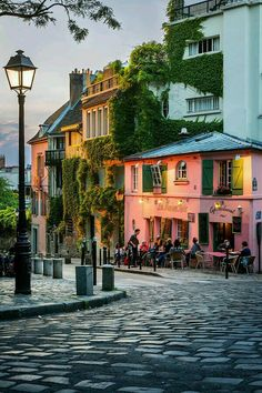 Setting sunlight on Le Maison Rose, Montmartre, Paris France. Montmartre really is a separate village in Paris. Montmartre Paris, Paris Paris, Streets Of Paris, Paris Movie, I Love Paris, Paris City, Paris Street, Places Around The World, The Places Youll Go