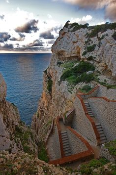 I'm tired just looking at these stairs. Who built these? Scalinata del Cabirol in Alghero, Sardinia, Italy Oh The Places You'll Go, Places To Travel, Places To Visit, Italy Vacation, Italy Travel, Alghero, Wonderful Places, Beautiful Places, Regions Of Italy