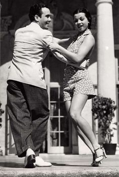 A gorgeous young couple lindy hop in 1935.