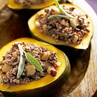 Stuffed Acorn Squash Recipe -sugar-free syrup can be substituted (1/2 the amount) for the brown sugar. Yum!
