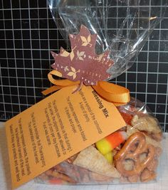 "Beth's Paper Cuts: Blessing Mix (""The Bugles are a symbol of the Cornucopia, a horn of plenty. The Pretzels represent arms folded in Thanks & Prayer. The Candy Corn reminds us that during the first winter, the pilgrims were allowed only five kernels of corn per day because the food was scarce. The Fruit is a reminder that Thanksgiving is the celebration of the harvest. The Peanuts represent seeds, the potential of the bounteous harvest of the next season if they are planted & well-tended."")"