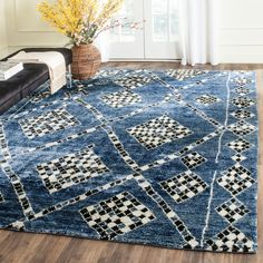 MOR553B Rug from Moroccan collection.  A modern expression nomadic design, this whimsical accent rug from the Moroccan collection by Safavieh is hand-knotted of viscose and cotton for light shee