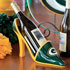 Green Bay Packers Shoe Wine Bottle Holder at the Packers Pro Shop http://www.packersproshop.com/sku/2008488076/