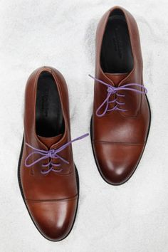 Tip: And, if all else fails, just take your favorite pair of luxurious lace-ups and add some colored laces to them, available all over (including your local J.Crew) for just a few bucks this season. They'll look even better when the shoes wear in a little. Leather dress shoes ($725) by Ermenegildo Zegna, available at select Ermenegildo Zegna stores, 888-880-3462; Laces ($6) by Benjo's, benjos.com.