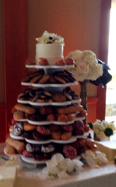 Donut tower with a personal bridal and groom's cake on top.