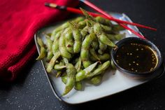Sweet and Spicy Soy Glazed Edamame. OH MY I HAVE TO TRY MAKING THIS! Tried it at a restaurant and it's officially my new fave food.
