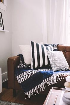 Leather couch with boho tribal blanket