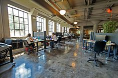 Interesting space, like the desks, floor is a bit much. Must be very loud in this space