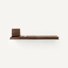 The Flap is a shelf and storage space in one sleek piece. It is completely linear and conceals a practical storage compartment inside the unit.