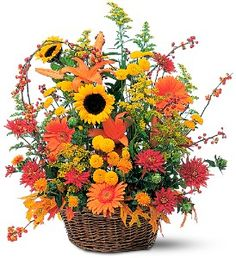 Majestic Fall: With gorgeous fall colors of yellow, rust and orange, this spectacular arrangement captures the essence of this colorful season. Available for same day delivery in Springfield, Ohio.