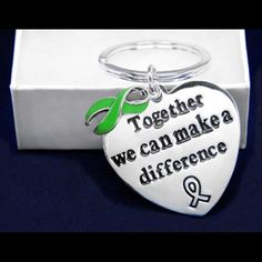 "Kidney Treatment Awareness Key Chain These sterling silver plated green ribbon key chains are a large heart that have the words ""Together We Can Make A Difference"" with a green ribbon charm. The heart is approximately 1 1/2 inches by 1 1/2 inches. Jewelry"