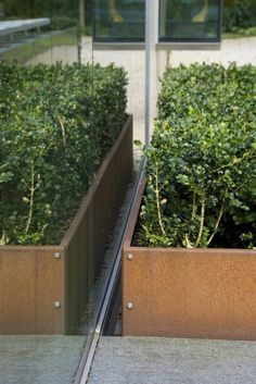 Robert Broekema, Rob & Renee Drake Corten planter boxes Pinned to Garden Design - Pots & Planters by Darin Bradbury.