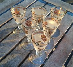 Looks like they are playing wine pong.  Vintage Gold Leaf Glasses <3