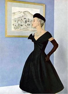 Christian Dior 1955. Black cocktail dress with long gloves and hat.