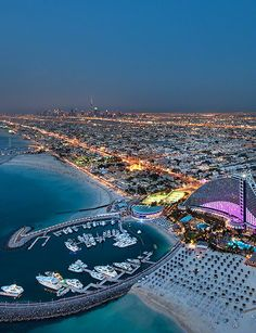 Not Abu Dhabi, but still worthy of pinning!Jumeira Beach Hotel and in the distance the Burj Khalifa - just down the road in Dubai, UAE Dubai Hotel, Dubai Uae, Dubai City, Burj Al Arab, Voyage Dubai, Landscape Photography, Travel Photography, Child Of The Universe, Dubai Travel