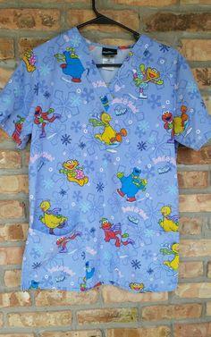 99d4ac0cefa Sesame Street XS Extra Small Nurse Dental Tech Medical Scrub Top Swirl and  Twirl   Clothing