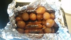 I like cooking more than a meal so that I have leftovers. First I have 5 polish sausage links in foil inside the RoadPro Portable Stove or lunchbox cooker as we call them. Then I added plenty of b… Lunch Box Recipes, Oven Recipes, Cooking Recipes, Baked Red Potatoes, Baby Potatoes, Pro Cook, Portable Stove, Coconut Chicken, How To Cook Sausage