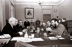 Fidel Castro smoking a cigar and wearing two Rolex watches during a meeting with Khrushchev, Kremlin, 1963