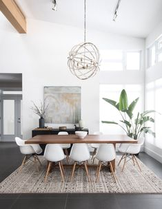 Gorgeous 30 Modern Minimalist Dining Room Design Ideas for Comfortable Dinner With Your Family Dining Room Decor decorating ideas for small dining room walls Yellow Dining Room, Dining Room Walls, Dining Room Lighting, Dining Room Design, Dining Chairs, Dining Nook, Ceiling Lighting, Dining Room With Rug, Room Chairs