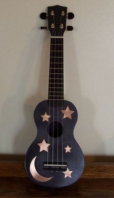 I just a ukelele for christmas :) Just a simple one is fine. Copper Sky Ukulele by TheSomberRaven on Etsy, $80.00