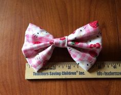 A personal favorite from my Etsy shop https://www.etsy.com/listing/215208559/strawberry-hello-kitty-fabric-hair-bow