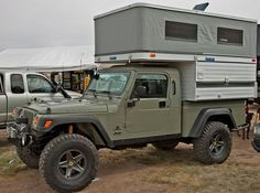 Its a Jeep...no Its a Camper.  No it both.  American Expedition Vehicles - Brute Kit  a manly man camper!!!