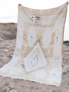 The Lennon is a beautifully faded vintage Moroccan rug in light cream and sandy tones, with faded coco and black highlights. It has an authentic vintage worn in feel, with the perfect amount of weight behind it so won't slip around on your floor. This one of a kind statement piece carries the story of it's former life in the Atlas Mountains of Morocco, and will add a gorgeous layer of warmth, texture and soul to your home. Vintage Wear, Vintage Rugs, Black Highlights, Light Cream, The Atlas, Atlas Mountains, Morocco, Rug Size, Dreaming Of You