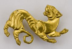 Snow Leopard Plaque (Scytho-Sakian, 5th-4th Century B.C.). Tomb of the Golden Warrior, Issyk, Kazakhstan. Gold, stamping. | © Museum of Gold and Precious Metals, Kazakhstan