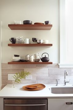 Backsplash, stained shelves and white countertops.