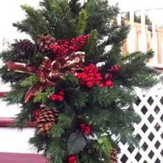 Recycled artificial trees used to make porch and door swags.