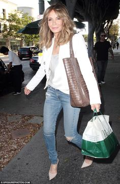 Fierce fashionista! The Charlie's Angels vet went effortlessly cool in distressed skinny jeans and pink stilettos