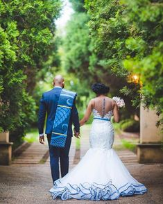 the beauty that is our traditions and culture ❤️❤️❤️ Our gorgeous bride draped in a custom design with shweshwe fabric detail,… African Print Wedding Dress, African Wedding Attire, African Traditional Wedding Dress, Traditional Wedding Attire, Blue Wedding Dresses, Bridal Dresses, Wedding Outfits, Shweshwe Dresses, Latest African Fashion Dresses
