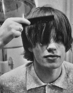 Mick Jagger getting a haircut. Looks like he needed a bang trim. Unlike me, he didn't do it himself after a night at the bar.