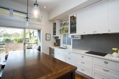 Bulimba renovation- This Queenslander was opened up for our clients who wanted a space that flowed with large open living areas and indoor/outdoor living. Walls were moved and a newly laid out kitchen created to update for modern living.⠀Everything feels more spacious and lets in more light and breeze.