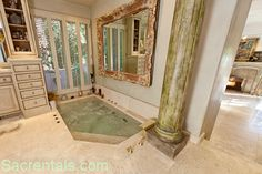 sunken jacuzzi bathtub, yes please! Next home I see this happening!