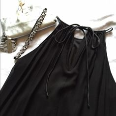 Grecian style • Black silk dress * picture taken with back side showing keyhole closure. Thats how I wore it...                      Dress by Maggy London. 100% silk dress. Dress is flowy just like a Grecian gown. So simple & beautiful. Worn to an event. Maggy London Dresses