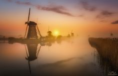 "Almost magical conditions during this misty day at Kinderdijk. Best view on black (click image or press ""M"")  Facebook : https://www.facebook.com/hermanvdberge.photography Instagram : https://www.instagram.com/herman_van_den_berge/"
